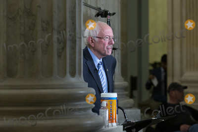 Bernie Sanders Photo - United States Senator Bernie Sanders (Independent of Vermont) speaks during a television interview in the Russell Senate Office Building in Washington D.C., U.S. on Wednesday, March 25, 2020.  The Senate is set to vote on a Coronavirus Stimulus Package after working late into the night on Tuesday to finalize a two trillion dollar deal.  Credit: Stefani Reynolds / CNP/AdMedia