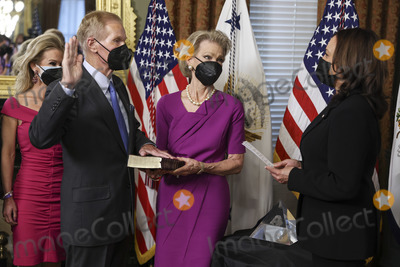 Bill Nelson, Kamala Harris, The National Photo - U.S. Vice President Kamala Harris, right, swears in Bill Nelson, left, former Democratic Senator from Florida and administrator of the National Aeronautics and Space Administration (NASA), alongside his wife, Grace Nelson, holding the bible, in the Eisenhower Executive Office Building in Washington, D.C., U.S., on May 3, 2021. The Senate confirmed Nelson on April 29 and had served as the chairman and ranking member of the Senate subcommittee that oversees NASA. Credit: Oliver Contreras / Pool via CNP/AdMedia