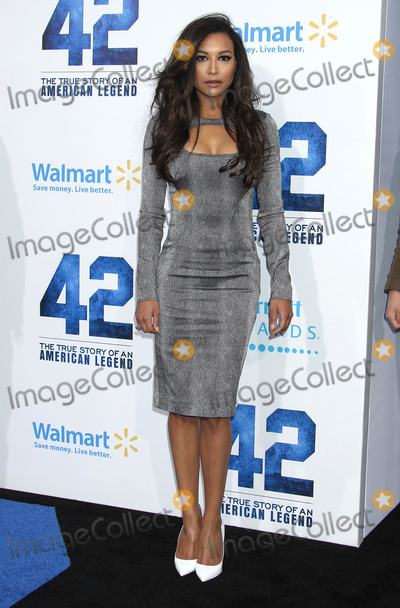 """Naya Rivera, TCL Chinese Theatre Photo - 13 July 2020 - Naya Rivera, the actress best known for playing cheerleader Santana Lopez on Glee, has been confirmed dead. Rivera, 33, is believed to have drowned while swimming in the lake with her 4-year-old son, who was found asleep on their rental pontoon boat after it was overdue for return. 09 April 2013 - Hollywood, California - Naya Rivera. """"42"""" Los Angeles Premiere held at the TCL Chinese Theatre. Photo Credit: Russ Elliot/AdMedia"""