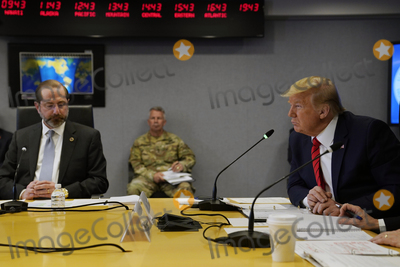 Donald Trump, Alex Azar Photo - United States President Donald J. Trump attends a teleconference with governors at the Federal Emergency Management Agency headquarters, Thursday, March 19, 2020, in Washington, DC. United States Secretary of Health and Human Services (HHS) Alex Azar looks on from left.