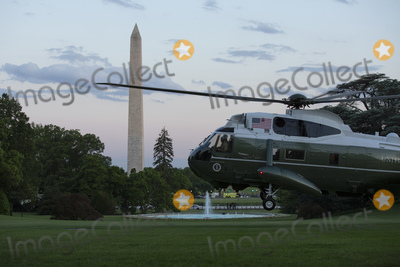 "Donald Trump, Kennedy, Marine One, White House, The White, The National Photo - Marine One, carrying United States President Donald J. Trump, approaches the South Lawn of the White House in Washington, D.C., U.S., as he arrives from the Kennedy Space Center in Florida on Saturday, May 30, 2020.  Trump vowed his administration would end what he called ""mob violence"" in U.S. cities following the death of an unarmed black man at the hands of Minnesota police, blaming leftist groups for clashes with police and property damage around the nation. 