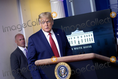 Usher, White House, The White Photo - United States President Donald J. Trump arrives to a news conference in the James S. Brady Press Briefing Room at the White House in Washington D.C., U.S. on Monday, August 10, 2020.  Trump was abruptly ushered out of the briefing room by Secret Service after shots were reportedly fired in the area.  Credit: Stefani Reynolds / CNP/AdMedia