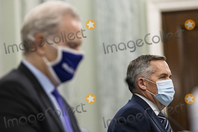 Richard Smith, The Vaccines Photo - Richard Smith (L), Regional President of the Americas and Executive Vice President of FedEx Express, and Wesley Wheeler (R), President of Global Healthcare at United Parcel Service (UPS), testify during a Senate Commerce, Science, and Transportation Subcommittee hearing on the logistics of transporting a COVID-19 vaccine in Washington, D.C. on December 10, 2020. Once a vaccine is approved by the FDA, emergency approval of Pfizers Covid vaccine coming as early as today, the next hurdle is making sure the vaccine gets to where it is most needed. Credit: Samuel Corum / Pool via CNP/AdMedia