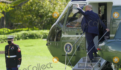 Melania Trump, Marine One, White House, The White, President Trump Photo - United States President Donald J. Trump gestures towards guests as he boards Marine One departing from the South Lawn of the White House in Washington, DC, on Friday, October 23, 2020. President Trump travels to The Villages, Florida and then on to Pensacola, Florida to deliver remarks at Make America Great Again Victory Rallies.    