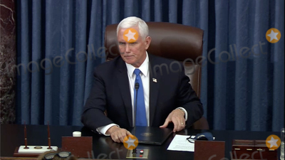Trump Impeachment, The Used, Mike Pence Photo - In this image from United States Senate television, US Vice President Mike Pence makes remarks as the US Senate reconvenes to resume debate on the Electoral Vote count following the violence in the US Capitol in Washington, DC on Wednesday, January 6, 2021.Mandatory Credit: US Senate Television via CNP/AdMedia