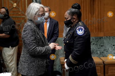 Photo - United States Senate Sergeant at Arms Karen Gibson speaks to acting US Capitol Police Chief Yogananda Pittman after a Senate Appropriations Subcommittee hearing to examine the FY 2022 budget request for the Architect of the Capitol, Senate Sergeant of Arms and the U.S. Capitol Police on Wednesday, April 21, 2021 at the U.S. Capitol in Washington, D.C.Credit: Greg Nash / Pool via CNP