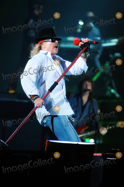 """Axl Rose, Guns N' Roses Photo - 24 January 2010 - Hamilton, Ontario, Canada.  Axl Rose of Guns N' Roses performs on stage at Copps Coliseum in support of """"Chinese Democracy"""". Photo Credit: Brent Perniac/AdMedia"""