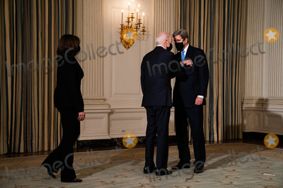 Joe Biden, John Kerry, The Specials, White House, The White, Kamala Harris Photo - John Kerry, the Special Presidential Envoy for Climate, greets President Joe Biden and Vice President Kamala Harris before the start of an event on the administrations response to climate change at an event in the State Dining Room of the White House in Washington DC, January 27th, 2021. Credit: Anna Moneymaker / Pool via CNP/AdMedia