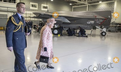 Beck, Elizabeth II, Queen, Queen Elizabeth, Queen Elizabeth II, Queen Elizabeth\, Train Photo - 03/02/2020 - Queen Elizabeth II with Station commander Group captain James Beck watches air crew at work on a training model F-35B Lightning II fighter at RAF Marham where she inspected the new integrated training centre that trains personnel on the maintenance of the new RAF F-35B Lightning II strike aircraft. Marham, Norfolk. Photo Credit: ALPR/AdMedia