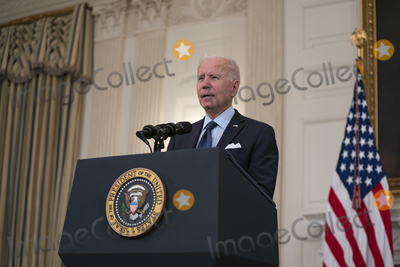 Joe Biden, The Vaccines, White House, The White Photo - United States President Joe Biden delivers remarks on the Covid-19 response and the vaccination program from the State Dining Room of the White House in Washington, DC on Tuesday, May 4, 2021.  The President announced he will allow some governors to turn down doses they don't need or want and reallocate those doses to other states and he also set a goal of getting at least one dose of the Covid-19 vaccine to 70 percent of adults by July 4.Credit: Alex Edelman / Pool via CNP/AdMedia