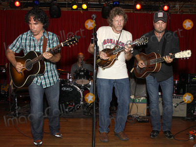 John Oates, Sam Bush, Guthrie Trapp, Hall & Oates, Pete Huttlinger, Hall & Oats Photo - July 26, 2011 - Nashville, TN - (l-r) John Oates of Hall & Oates, award-winning Bluegrass artist Sam Bush and session guitarist Gurhtie Trapp. Artists, musicians and songwriters came together at Mercy Lounge to help raise funds for Pete Huttlinger, a widely respected guitarist and Nashville studio artist.  Huttlinger has a congenital heart disease and is in need of a heart transplant. Photo credit: Dan Harr/Admedia