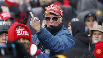 Joe Biden Photo - A supprter gestures towards the media as US President Donald J. Trump delivers remarks to supporters gathered to protest Congress' upcoming certification of Joe Biden as the next president on the Ellipse in Washington, DC, USA, 06 January 2021. Various groups of Trump supporters are gathering to protest as Congress prepares to meet and certify the results of the 2020 US Presidential election.Credit: Shawn Thew / Pool via CNP/AdMedia