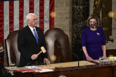 Joe Biden, Nancy Pelosi, Representative Nancy Pelosi, The Unit, Mike Pence Photo - Speaker of the United States House of Representatives Nancy Pelosi (Democrat of California), right, listens as U.S. Vice President Mike Pence speaks during a joint session of Congress to count the Electoral College votes of the 2020 presidential election in the House Chamber in Washington, D.C., U.S., on Wednesday, Jan. 6, 2021. Congress is meeting to certify Joe Biden as the winner of the 2020 presidential election, with scores of Republican lawmakers preparing to challenge the tally in a number of states during what is normally a largely ceremonial event. 