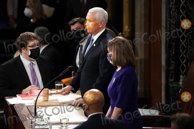 Mike Pence Photo - United States Vice President Mike Pence gavels out a joint session of Congress to count the Electoral College votes from the 2020 presidential election on Wednesday, January 6, 2021.Credit: Greg Nash / Pool via CNP/AdMedia