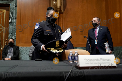 Photo - Acting United States Capitol Police chief Yogananda Pittman arrives for a Senate Appropriations Subcommittee hearing to examine the FY 2022 budget request for the Architect of the Capitol, Senate Sergeant of Arms and the U.S. Capitol Police on Wednesday, April 21, 2021 at the U.S. Capitol in Washington, D.C.Credit: Greg Nash / Pool via CNP