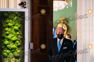 Joe Biden, White House, The White Photo - United States President Joe Biden arrives to deliver remarks during a virtual Leaders Summit on Climate, in the East Room of the White House in Washington DC on April 23rd, 2021. Credit: Anna Moneymaker / Pool via CNP/AdMedia