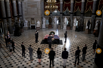 Photo - Capitol Hill staffers pay their respects as the late Justice Ruth Bader Ginsburg lies in state at National Statuary Hall in the U.S. Capitol on Friday, September 25, 2020. Ginsburg died at the age of 87 on Sept. 18th and is the first women to lie in state at the Capitol.Credit: Greg Nash / Pool via CNP/AdMedia