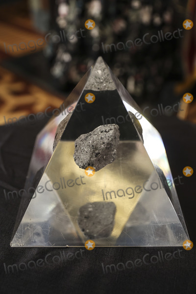 Bill Nelson, Kamala Harris, The National Photo - A moon rock encased in acrylic sits on a table ahead of Bill Nelson, former Democratic Senator from Florida and administrator of the National Aeronautics and Space Administration (NASA), during a swearing in ceremony with U.S. Vice President Kamala Harris, in the Eisenhower Executive Office Building in Washington, D.C., U.S., on May 3, 2021. The Senate confirmed Nelson on April 29 and had served as the chairman and ranking member of the Senate subcommittee that oversees NASA. Credit: Oliver Contreras / Pool via CNP/AdMedia