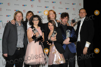 Arcade Fire Photo - 27 March 2011 - Toronto, Ontario, Canada - Arcade Fire.  Arcade Fire won four trophies including album of the year during the 40th Annual Juno Awards at the Air Canada Centre. Photo: Brent Perniac/AdMedia