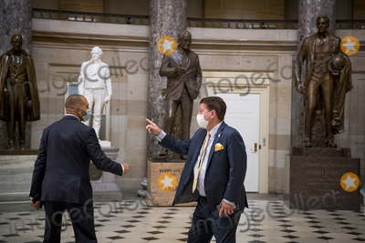 The Used, Hakeem Jeffries Photo - United States Representative Hakeem Jeffries (Democrat of New York), left, greets a man in Statuary Hall as members of Congress vote on two House resolutions at the US Capitol in Washington, DC., Friday, October 2, 2020. The Resolutions are: House Resolution 1153: Condemning unwanted, unnecessary medical procedures on individuals without their full, informed consent and House Resolution 1154: Condemning QAnon and rejecting the conspiracy theories it promotes. Credit: Rod Lamkey / CNP/AdMedia