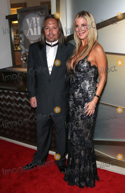 Alicia Jacobs, Vince Neil, Priscilla Presley Photo - 29 January 2011 - Las Vegas, Nevada - Vince Neil, Alicia Jacobs.  Priscilla Presley is honored by the Nevada Ballet Theatre as its 2011 Women of the Year at the Black and White Ball at Aria Resort and Casino at CityCenter. Photo: MJT/AdMedia
