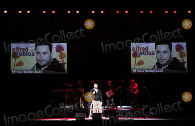 Alfred Robles, Gabriel Iglesias, Ozomatli Photo - March 14, 2013 - Atlanta, GA - Comedian Alfred Robles performed as part of Gabriel Iglesias' Stand Up Revolution Tour when it made a stop at The Tabernacle in Atlanta, GA. Six comics and the Grammy-winning band Ozomatli performed for two sold-out nights in the southern capital. Photo credit: Dan Harr/AdMedia