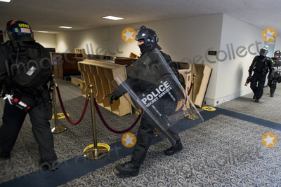 The Unit, The Used Photo - Members of a Secret Service tactical team arrive as Senators evacuate to a safe place in the Dirksen Senate Office Building after Electoral votes being counted during a joint session of the United States Congress to certify the results of the 2020 presidential election in the US House of Representatives Chamber in the US Capitol in Washington, DC on Wednesday, January 6, 2021, as interrupted as thousands of pr-Trump protestors stormed the U.S. Capitol and the House chambers.  .Credit: Rod Lamkey / CNP/AdMedia