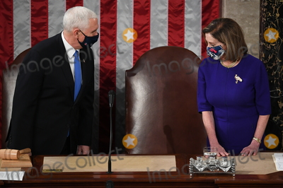 The Used, Mike Pence Photo - US Vice President Mike Pence presides over a joint session of Congress to count the electoral votes for President at the US Capitol in Washington, DC, January 6, 2021.Credit: Saul Loeb / Pool via CNP/AdMedia