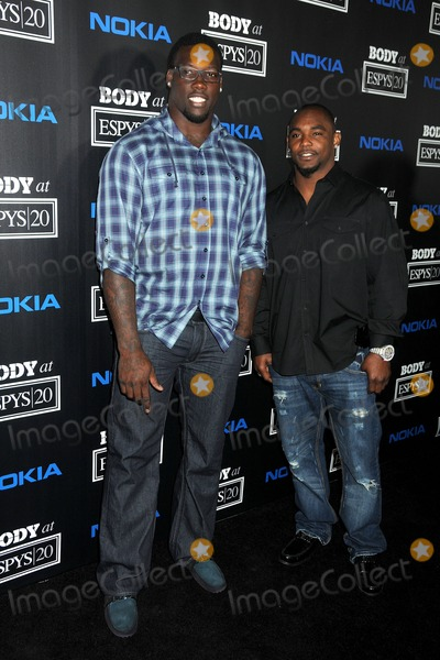 Ahmad Bradshaw, Jason Pierre-Paul, Pierre Bergé Photo - 10 July 2012 - Los Angeles, California - Jason Pierre-Paul, Ahmad Bradshaw. 4th Annual ESPN Body Issue Pre-ESPYS Party held at The Belasco Theater. Photo Credit: Byron Purvis/AdMedia