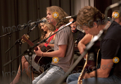 Bucky Covington, Craig Morgan, Sarah Darling Photo - August 7, 2011 - Nashville, TN - Bucky Covington sings as Sarah Darling and Craig Morgan listen. A concert was held on day 2 of the Craig Morgan Charity Weekend to raise money for Billy's Place, a home for temporarily displaced children. Photo credit: Dan Harr/AdMedia