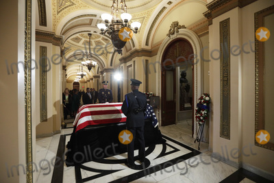"Elijah Cummings, The Used, Alex Wong Photo - Honor guard stand next to the flag-draped casket of United States Representative Elijah Cummings (Democrat of Maryland) as the late congressman lies in state outside the US House chamber at the U.S. Capitol October 24, 2019 in Washington, DC. Rep. Cummings passed away on October 17, 2019 at the age of 68 from ""complications concerning longstanding health challenges.""  