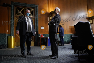 Barack Obama, Joe Biden Photo - Denis McDonough, U.S. secretary of Veterans Affairs (VA) nominee for U.S. President Joe Biden, right, and United States Senator Jon Tester (Democrat of Montana) and ranking member of the Senate Veterans' Affairs Committee, wear protective masks while talking before a confirmation hearing in Washington, D.C., U.S., on Wednesday, Jan. 27, 2021. As Barack Obama's chief of staff, McDonough oversaw the VAs overhaul in response to its 2014 wait-time scandal and previously served as a deputy national security adviser. Credit: Sarah Silbiger / Pool via CNP/AdMedia