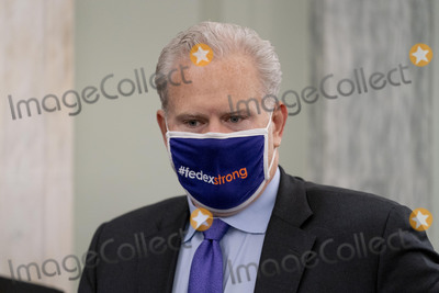 Richard Smith Photo - FedEx Express Regional President of the Americas and Executive Vice President Richard Smith arrives for a Senate Transportation subcommittee hybrid hearing on transporting a coronavirus vaccine on Capitol Hill, Thursday, Dec. 10, 2020, in Washington.Credit: Andrew Harnik / Pool via CNP/AdMedia