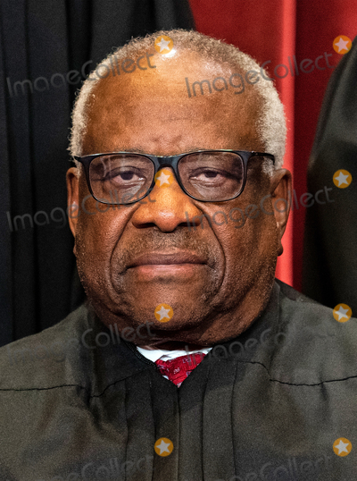 Supremes, The Supremes, CLARENCE THOMAS, Group Photo, Supreme Court Photo - Associate Justice of the Supreme Court Clarence Thomas sits during a group photo of the Justices at the Supreme Court in Washington, DC on April 23, 2021. Credit: Erin Schaff / Pool via CNP/AdMedia