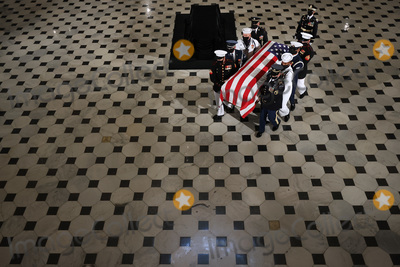 Bill Clinton, President Bill Clinton, Supremes, Supreme Court Photo - A U.S. military carry team moves U.S. Supreme Court Associate Justice Ruth Bader Ginsburg's flag-draped casket out of Statuary Hall after she layed in state at the U.S. Capitol on September 25, 2020 in Washington, DC. Ginsburg, who was appointed by former U.S. President Bill Clinton, served on the high court from 1993 until her death on September 18, 2020. She is the first woman to lie in state at the Capitol. Credit: Chip Somodevilla / Pool via CNP/AdMedia