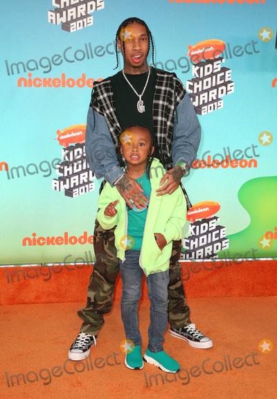 Tyga, King Sunny Adé Photo - 23 March 2019 - Los Angeles, California - Tyga and King Cairo. 2019 Nickelodeon Kids' Choice Awards held at The USC Galen Center. Photo Credit: Faye Sadou/AdMedia