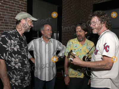 Sam Bush, Jeff Taylor, Buddy Greene, Pete Huttlinger Photo - July 26, 2011 - Nashville, TN - Jeff Taylor, Buddy Greene, Jim Hoke and Sam Bush. Artists, musicians and songwriters came together at Mercy Lounge to help raise funds for Pete Huttlinger, a widely respected guitarist and Nashville studio artist.  Huttlinger has a congenital heart disease and is in need of a heart transplant. Photo credit: Dan Harr/Admedia