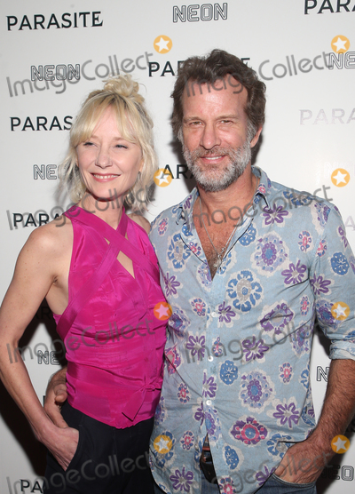 "Ann Heche, Anne Heche, Thomas Jane Photo - 2 October 2019 - Hollywood, California - Anne Heche, Thomas Jane. Neon Presents Los Angeles Premiere Of ""Parasite"" held at ArcLight Hollywood. Photo Credit: FSadou/AdMedia"