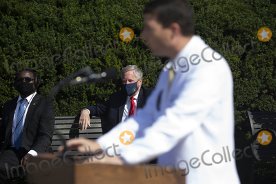 White House, Mark Meadows Photo - White House Chief of Staff Mark Meadows (Back) listens to Commander Sean Conley (Front), Physician to the President, give an update on the condition of US President Donald J. Trump at Walter Reed National Military Medical Center, where Trump is receiving treatment after testing positive for Covid, in Bethesda, Maryland, USA, 04 October 2020.Credit: Michael Reynolds / Pool via CNP/AdMedia