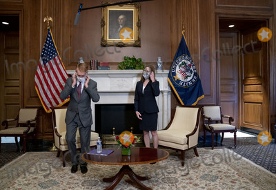 Donald Trump, Supremes, The Supremes, The Unit, Supreme Court Photo - Judge Amy Coney Barrett, President Donald Trump's nominee for the Supreme Court of the United States, removes her protective mask before she poses for a photo with United States Senator James Lankford (Republican of Oklahoma) on Capitol Hill in Washington DC, on October 21, 2020. The Senate aims to vote on October 26, 2020 to confirm Judge Amy Coney Barrett to the Supreme Court.Credit: Leigh Vogel / Pool via CNP/AdMedia