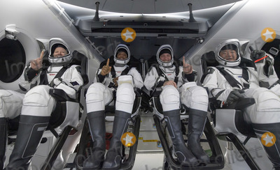 The Interns, Mike Hopkins Photo - NASA astronauts Shannon Walker, left, Victor Glover, Mike Hopkins, and Japan Aerospace Exploration Agency (JAXA) astronaut Soichi Noguchi, right are seen inside the SpaceX Crew Dragon Resilience spacecraft onboard the SpaceX GO Navigator recovery ship shortly after having landed in the Gulf of Mexico off the coast of Panama City, Florida, Sunday, May 2, 2021.  NASAs SpaceX Crew-1 mission was the first crew rotation flight of the SpaceX Crew Dragon spacecraft and Falcon 9 rocket with astronauts to the International Space Station as part of the agencys Commercial Crew Program.Mandatory Credit: Bill Ingalls / NASA via CNP/AdMedia