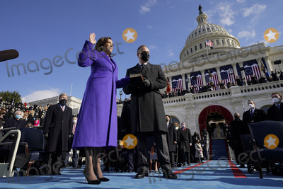 Joe Biden, Supremes, Kamala Harris, Supreme Court Photo - Kamala Harris is sworn in as Vice President by Supreme Court Justice Sonia Sotomayor as her husband Doug Emhoff holds the Bible during the 59th Presidential Inauguration at the U.S. Capitol in Washington, Wednesday, Jan. 20, 2021. (AP Photo/Andrew Harnik, Pool)/AdMedia