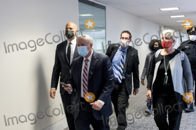Booker, Cory Booker, Lindsey Graham, Senator Lindsey Graham, The Unit, The Used Photo - United States Senator Cory Booker (Democrat of New Jersey), left, and United States Senator Lindsey Graham (Republican of South Carolina), second from left, and other Senators evacuate to a safe place in the Dirksen Senate Office Building after Electoral votes being counted during a joint session of the United States Congress to certify the results of the 2020 presidential election in the US House of Representatives Chamber in the US Capitol in Washington, DC on Wednesday, January 6, 2021, as interrupted as thousands of pr-Trump protestors stormed the U.S. Capitol and the House chambers.  .Credit: Rod Lamkey / CNP/AdMedia