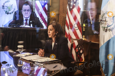 White House, The White, Kamala Harris Photo - United States Vice President Kamala Harris, center right, speaks during a virtual bilateral meeting with President Alejandro Giammattei of Guatemala, on screen at left, in the Vice President's Ceremonial Office in the Eisenhower Executive Office Building on the White House campus, about the migration crisis on April 26, 2021, in Washington, DC. Credit: Oliver Contreras / Pool via CNP/AdMedia