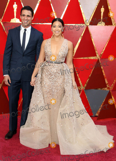 Gina Rodriguez, Joe Corré Photo - 04 March 2018 - Hollywood, California - Joe LoCicero, Gina Rodriguez. 90th Annual Academy Awards presented by the Academy of Motion Picture Arts and Sciences held at Hollywood & Highland Center. Photo Credit: AdMedia