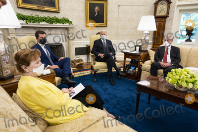 Angus King, White House, The White, Pete Buttigieg Photo - United States makes remarks during a meeting with with a bipartisan group of Members of Congress to discuss historic investments in the American Jobs Plan, in the Oval Office of the White House in Washington, DC, Monday, April, 19, 2021.  Pictured from left to right: United States Representative Kay Grainger (Republican of Texas), US Secretary of Transportation Pete Buttigieg, President Biden, and US Senator Angus King, Jr. (Independent of Maine)Credit: Doug Mills / Pool via CNP