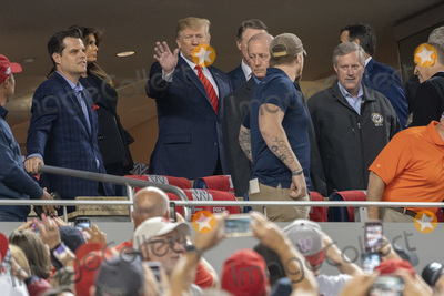 Donald Trump, Melania Trump, TI, Matt Gaetz, Mark Meadows Photo - United States President Donald J. Trump and First lady Melania Trump attend game five of the World Series at Nationals Park in Washington DC on October 27, 2019. The Washington Nationals and Houston Astros are tied at two games going into tonight's game. Pictured attending with the president include United States Representative Matt Gaetz (Republican of Florida), United States Senator David Perdue (Republican of Georgia) and United States Representative Mark Meadows (Republican of North Carolina).