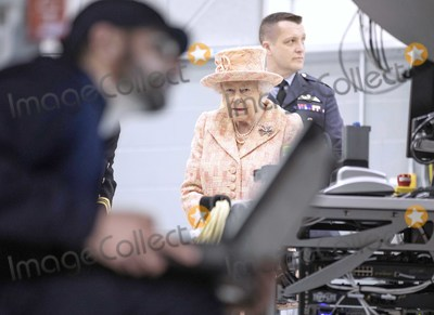 Elizabeth II, Queen, Queen Elizabeth, Queen Elizabeth II, Queen Elizabeth\, Train Photo - 03/02/2020 - Queen Elizabeth II watches air crew at work on a training model F-35B Lightning II fighter at RAF Marham where she inspected the new integrated training centre that trains personnel on the maintenance of the new RAF F-35B Lightning II strike aircraft. Marham, Norfolk. Photo Credit: ALPR/AdMedia