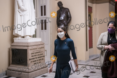 Alexandria Ocasio-Cortez Photo - United States Representative Alexandria Ocasio-Cortez (Democrat of New York) arrives at the House chamber during a vote on House Resolution 72: Removing a certain Member from certain standing committees of the House of Representatives, at the U.S. Capitol in Washington, DC, Thursday, February 4, 2021. Credit: Rod Lamkey / CNP/AdMedia