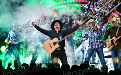 """Garth Brooks, Trisha Yearwood Photo - 20 June 2020 - """"Garth Brooks: The Road I'm On"""" documentary follows Brooks' life and career as well as that of his wife Trisha Yearwood. File Photo: Garth Brooks performs on stage in 2016 at FirstOntario Centre, Hamilton, Ontario, Canada. Photo Credit: Brent Perniac/AdMedia"""